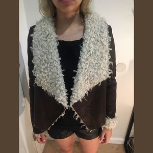 Leather jacket lined with faux fur on the inside